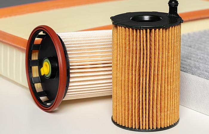 Fibras bi-componentes para filtração